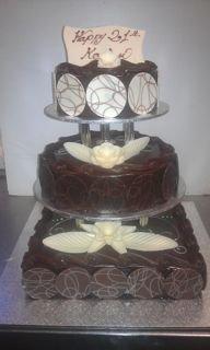 3 TIER MUD CAKE WITH PILLARS