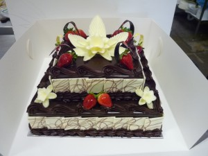 Cake Art Opening Hours : 2 TIER MUD CAKE WITH WHITE CHOCOLATE FLOWERS Orangerie ...