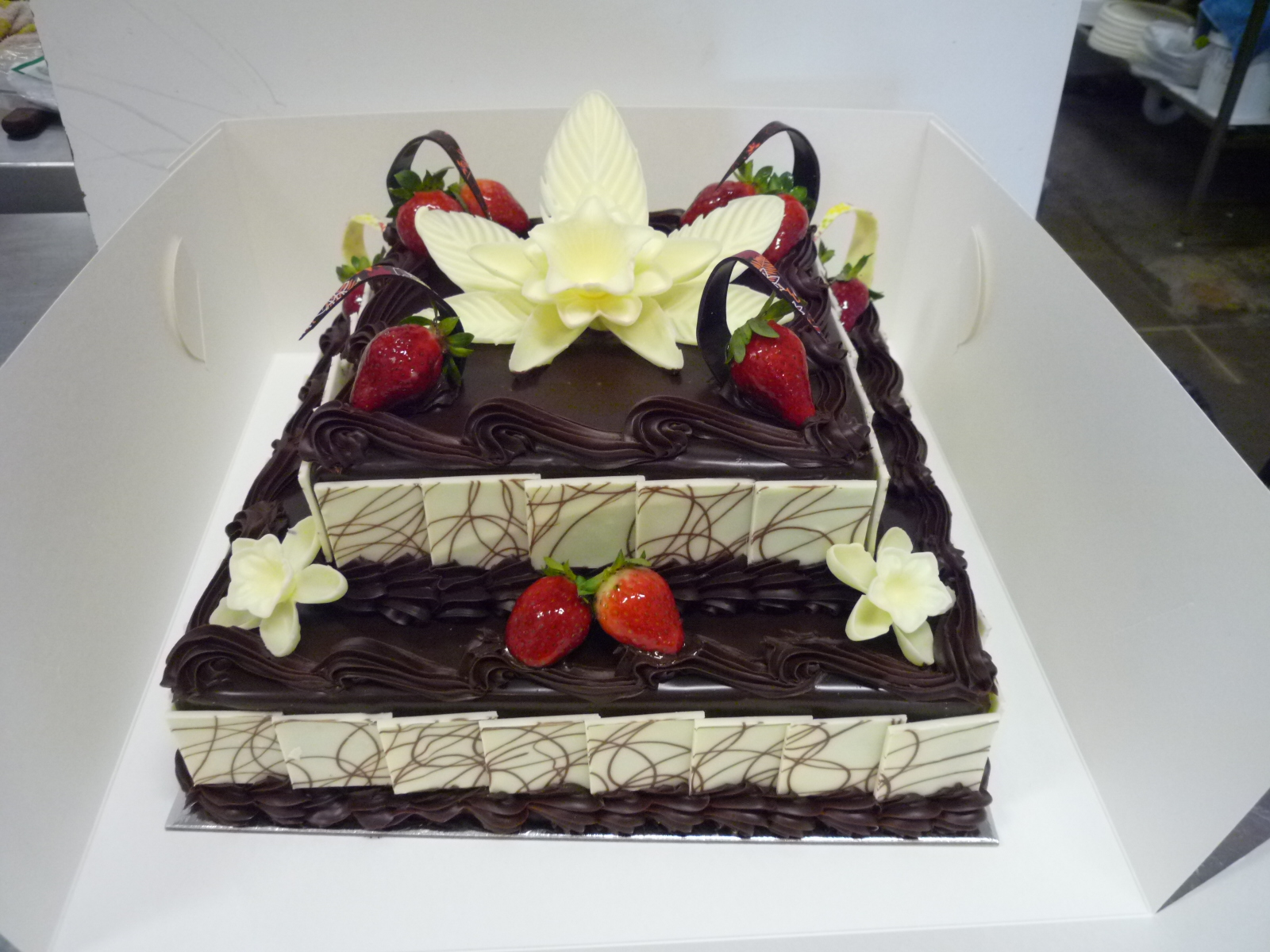 2 tier mud cake with white chocolate flowers orangerie patisserie 2 tier mud cake with white chocolate flowers izmirmasajfo